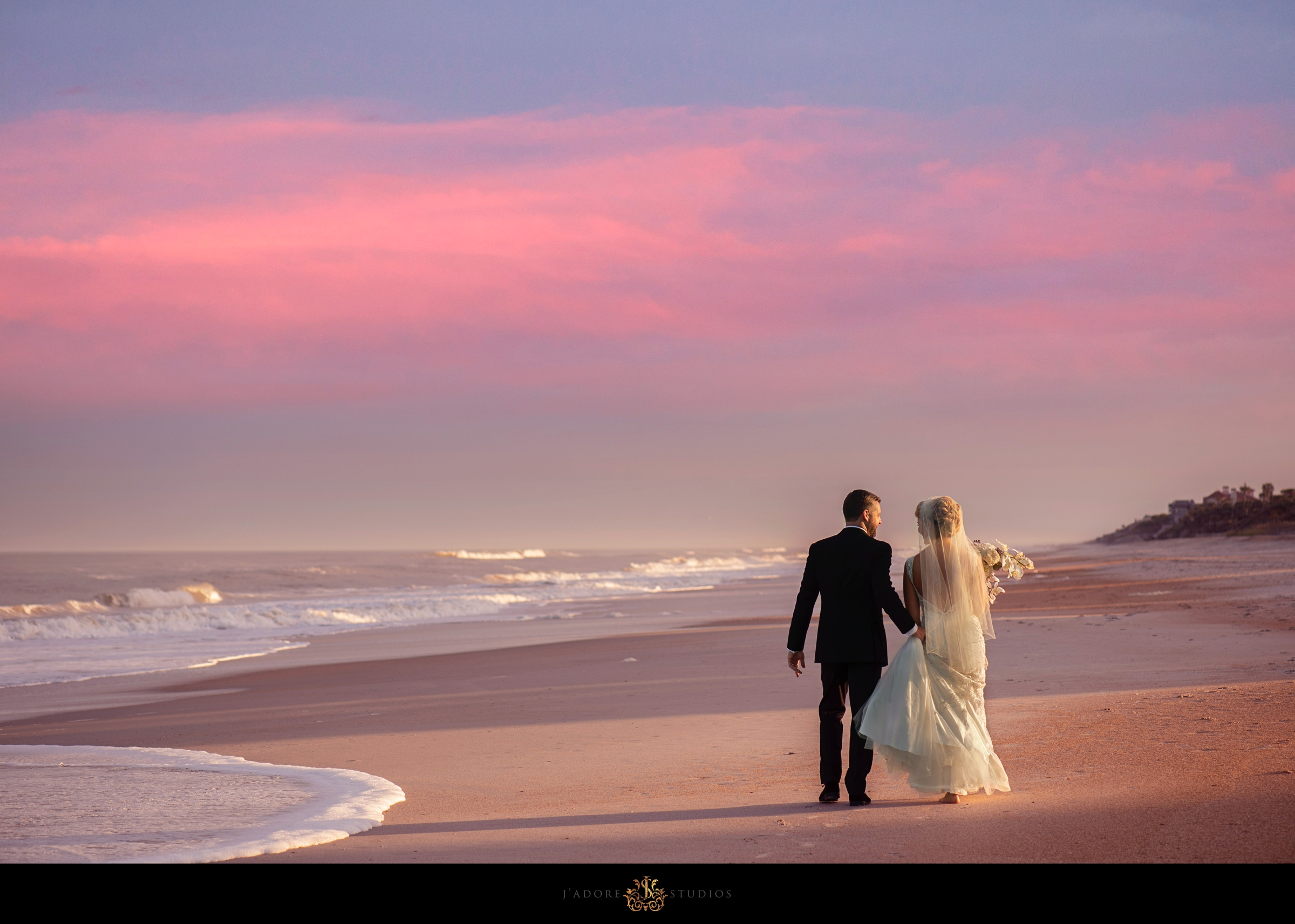 Couple walking on the beach at the Ponte Vedra Inn and Club