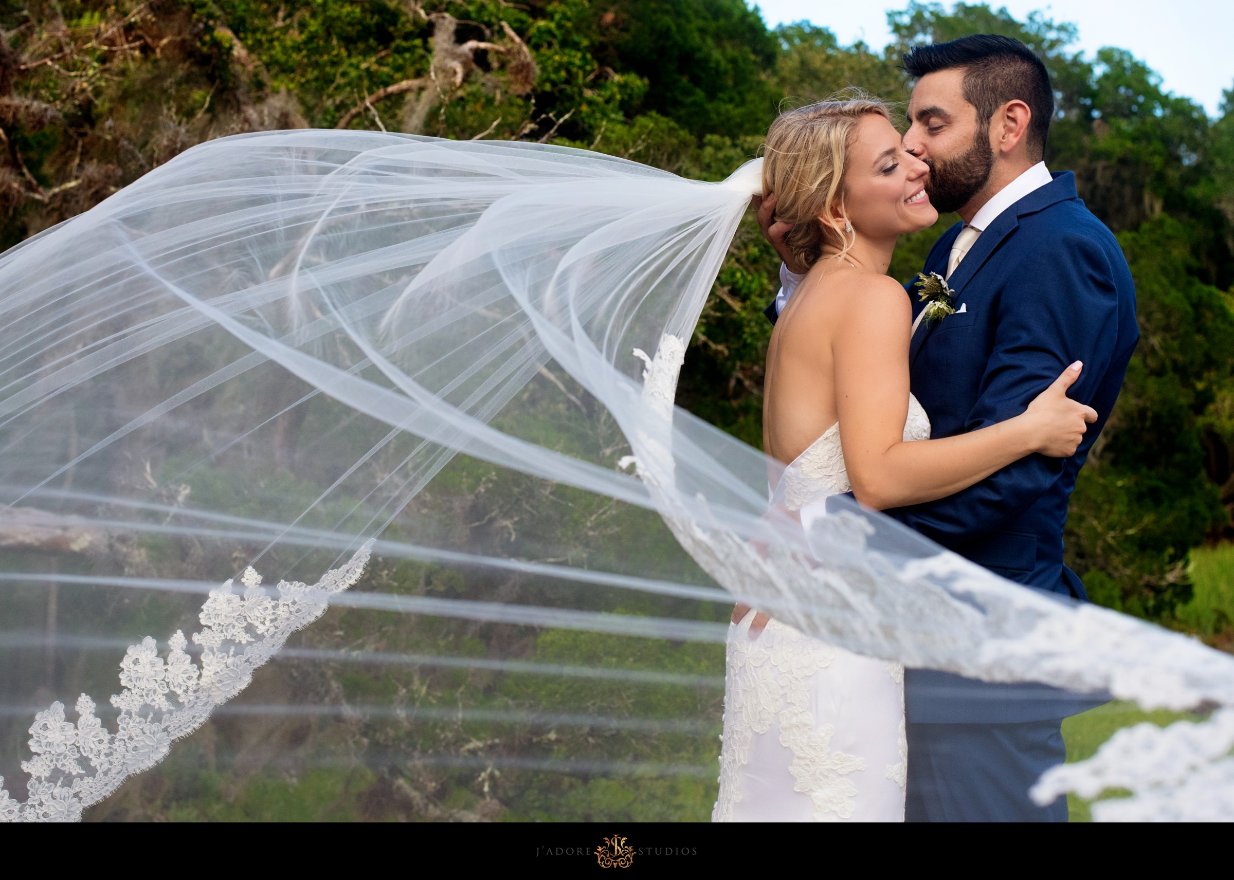 Couple kissing on the dock at Walkers Landing in Amelia Island Jacksonville Wedding Venue