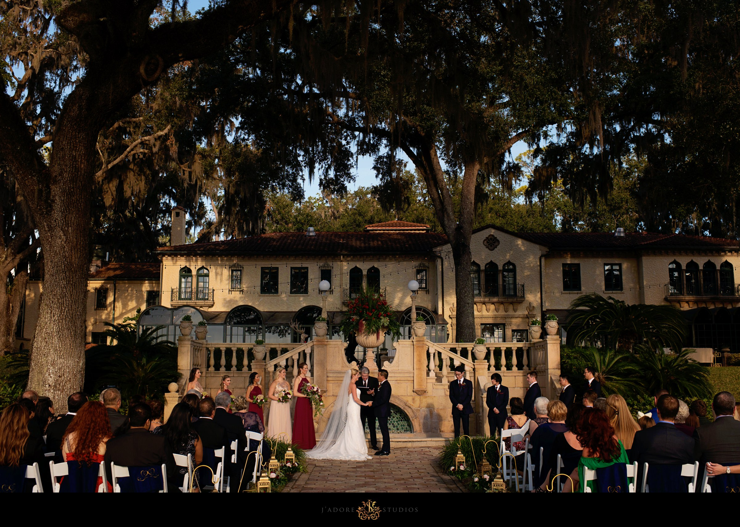 Ceremony at Epping Forest Yacht Club Jacksonville Wedding Venue.  Bride and groom saying vows in front of guests and bridal party