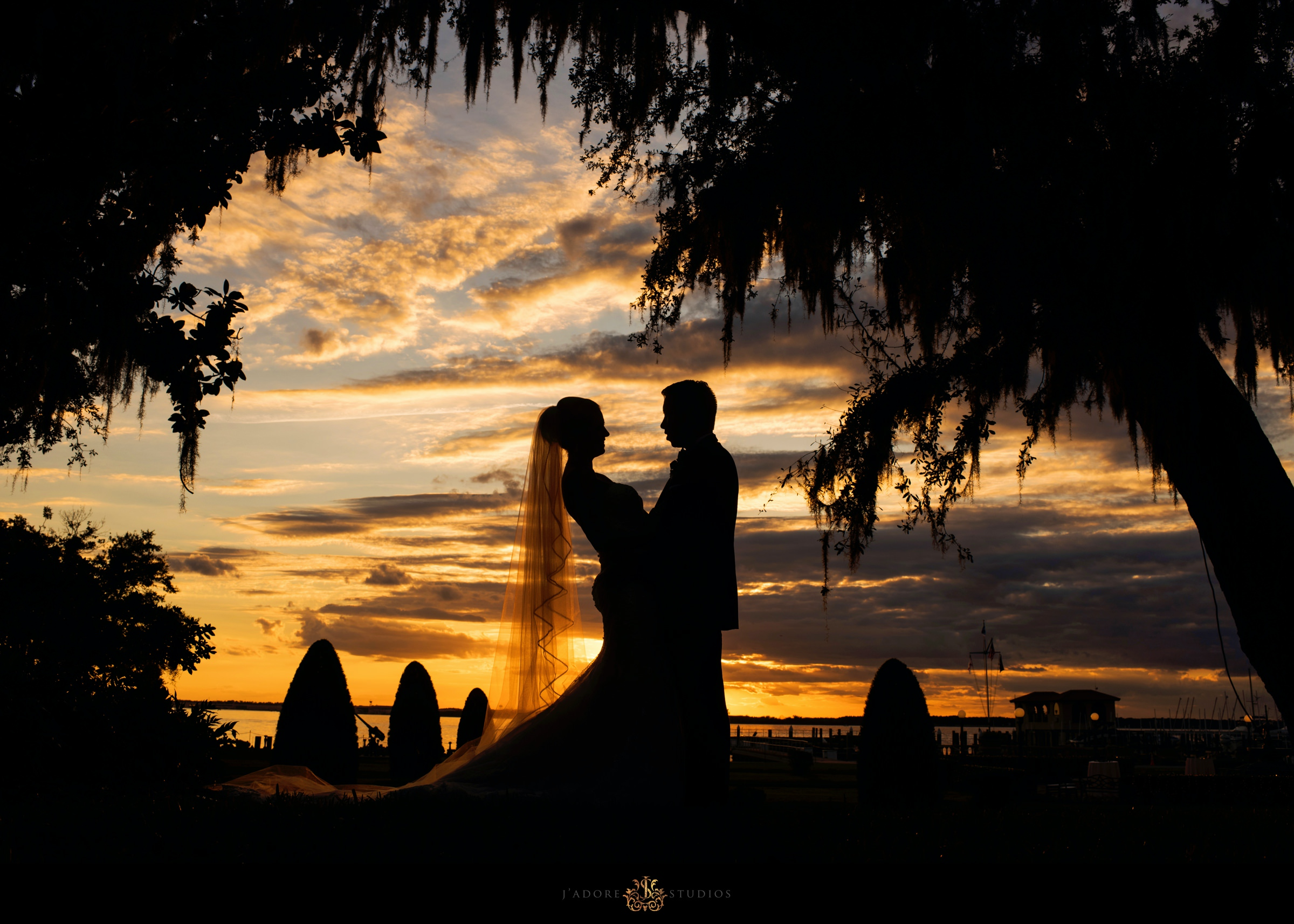 Sunset silhouette photo of bride and groom at Epping Forest Yacht Club