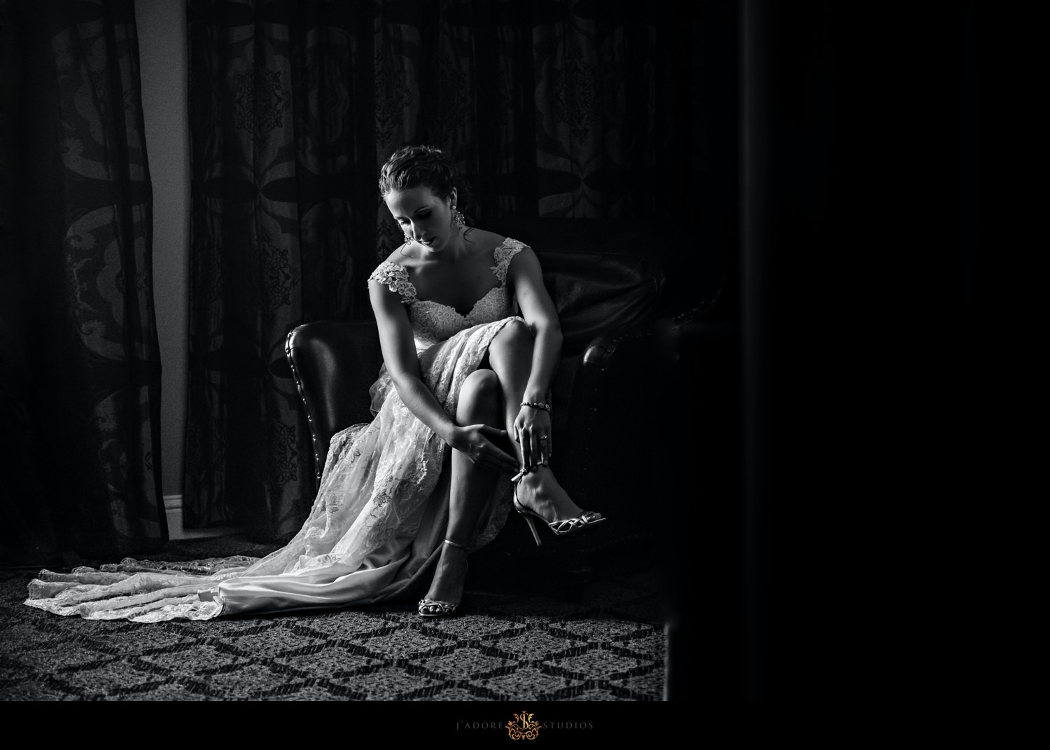 Bride putting on shoes in the Casa Monica Hotel & Spa in Saint Augustine Florida