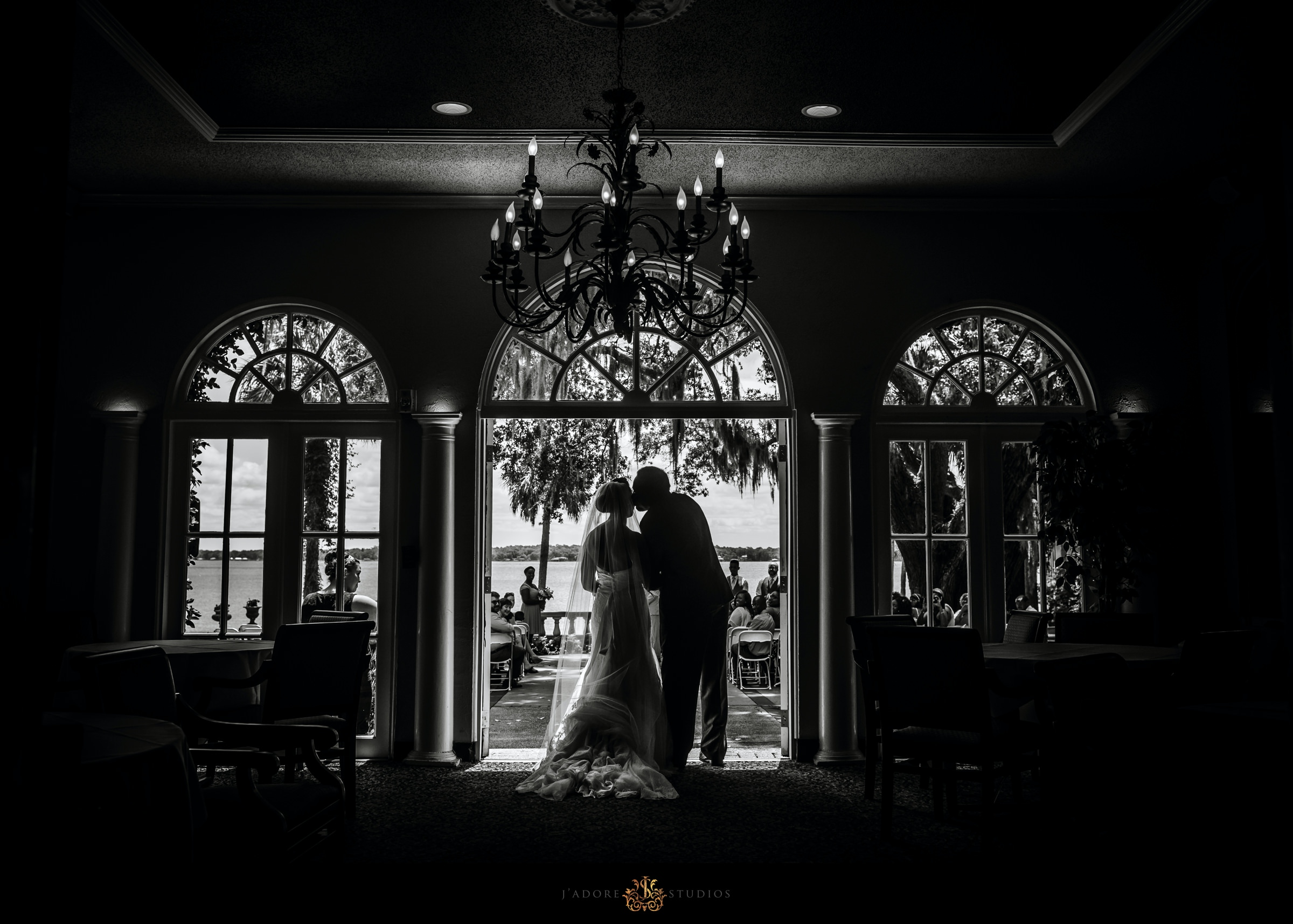 Groom kissing bride's cheek before he walks her down the aisle at Club Continental