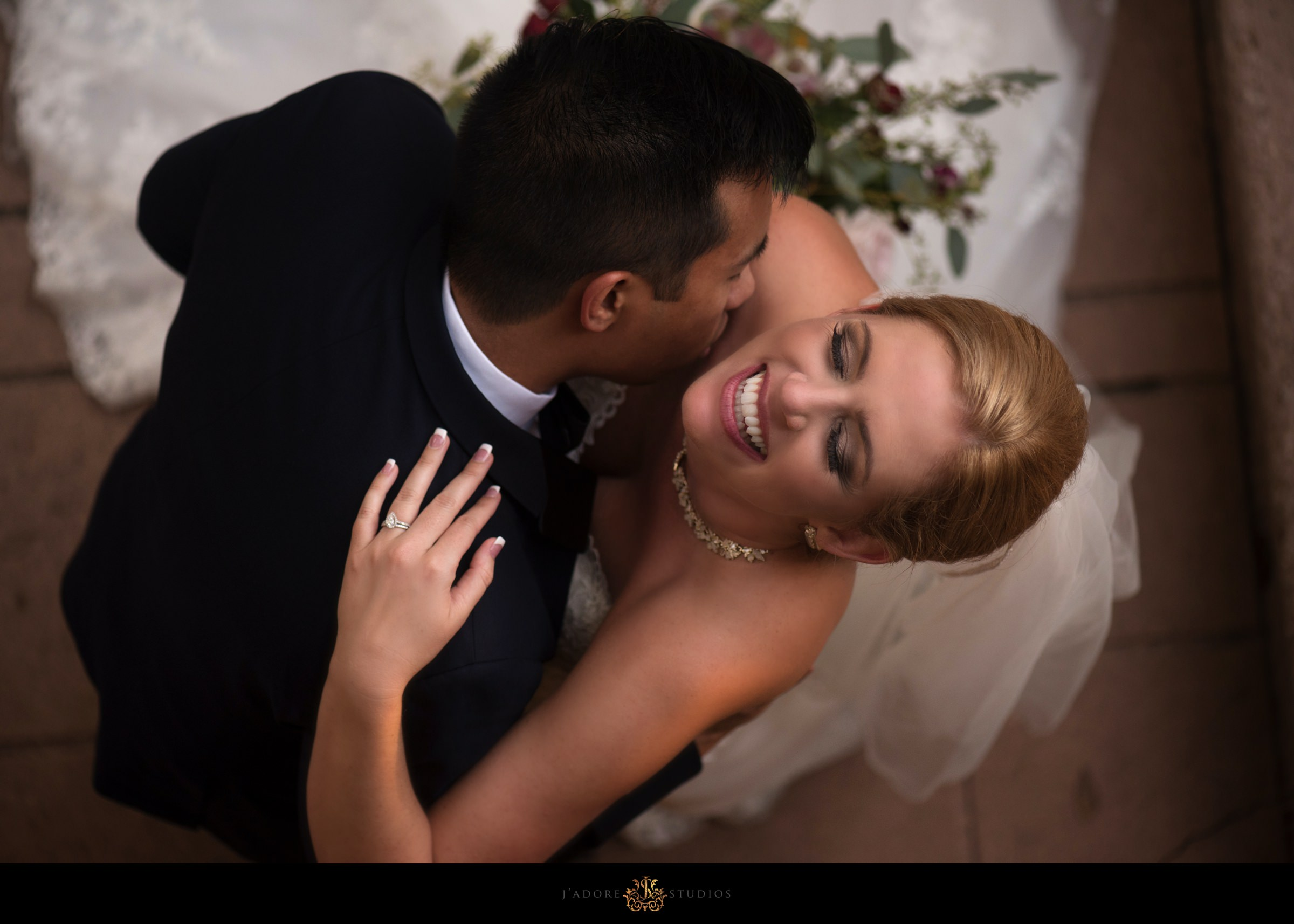 Groom kisses bride at Epping Forest Yacht Club