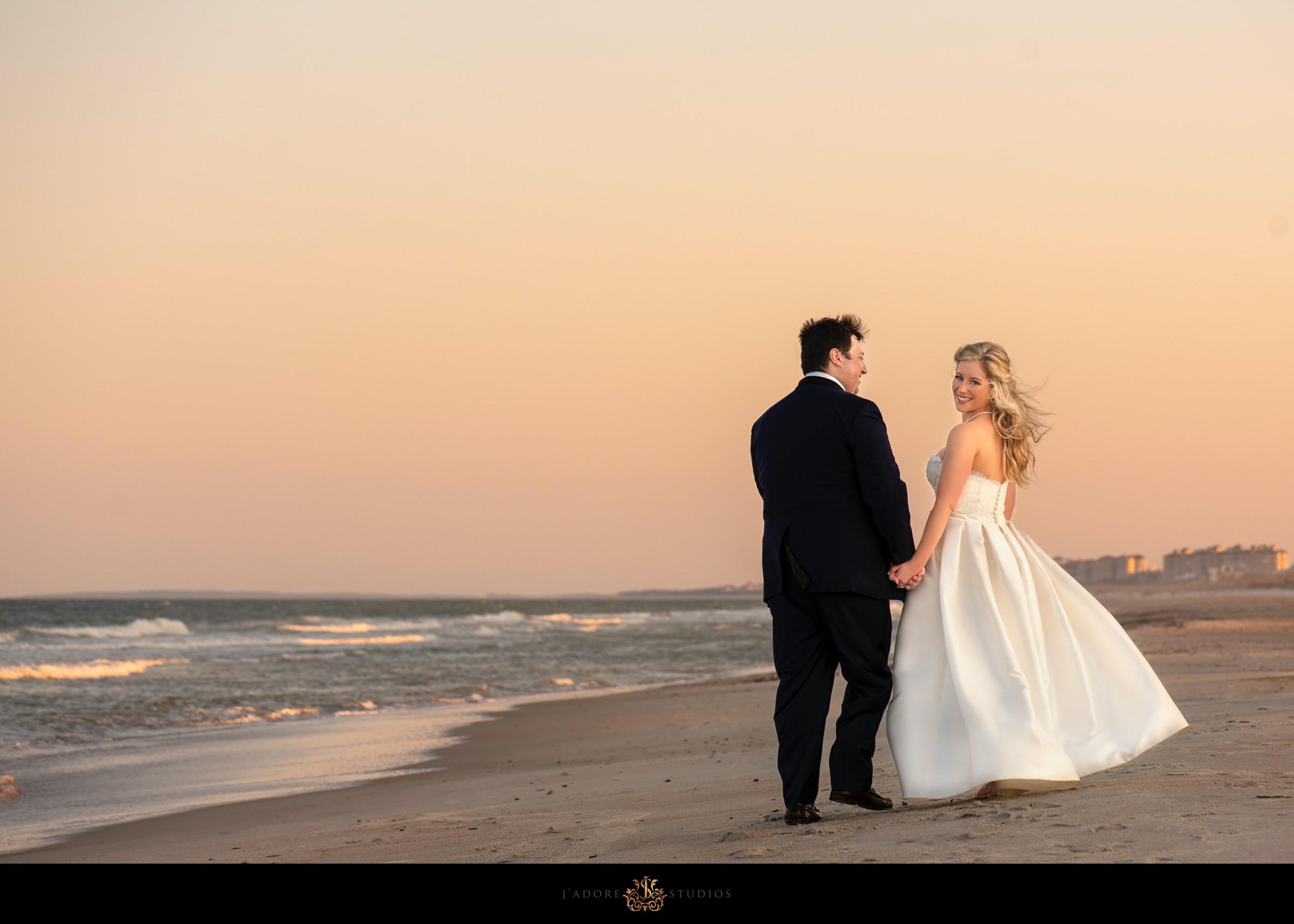 Couple walking on the beach at the Ritz Carlton in Amelia Island
