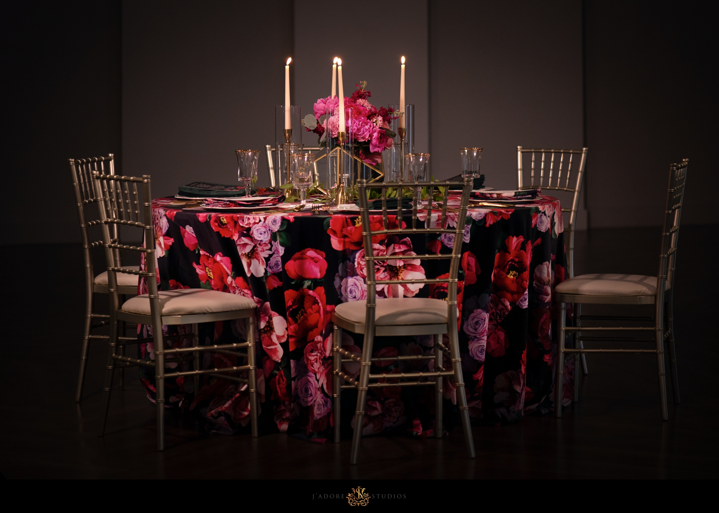 Floral linen with pink and red flowers at Clay Theatre