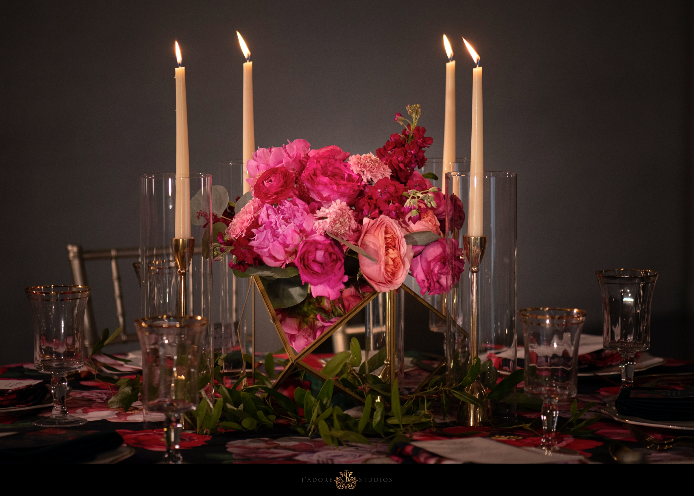 Bold colorful pink floral details with white candles at the Clay Theatre