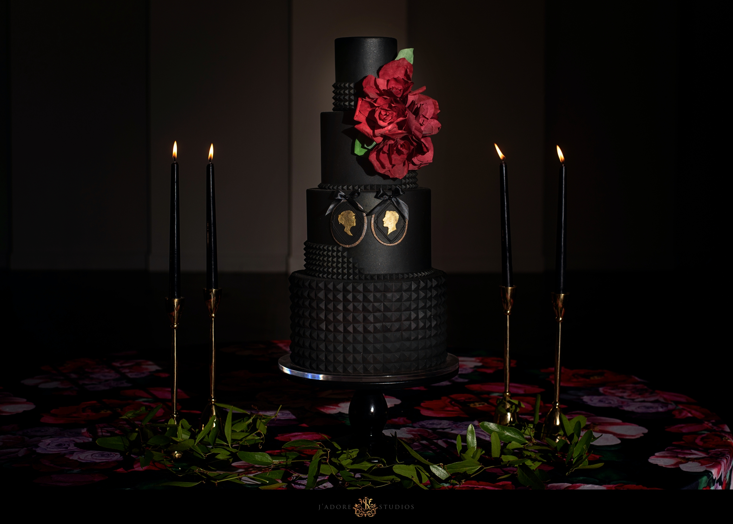 Black gold and red wedding cake