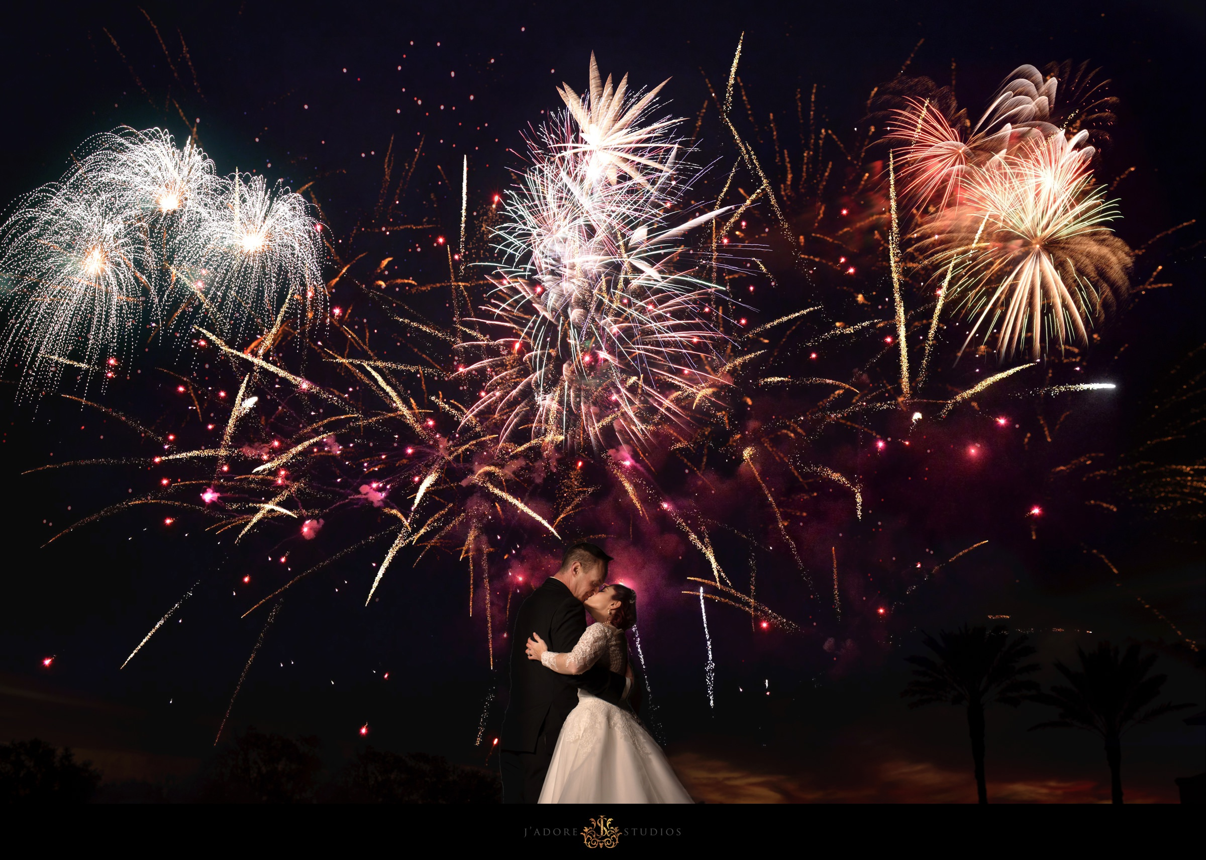 Couple kissing with Fireworks on TPC Sawgrass lawn