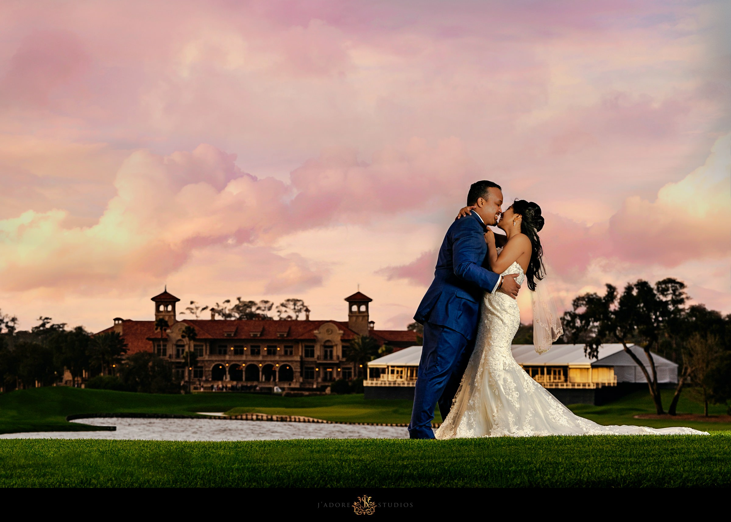 Couple kissing on 17th hole with a view of the TPC Sawgrass Clubhouse Jacksonville Wedding Venue