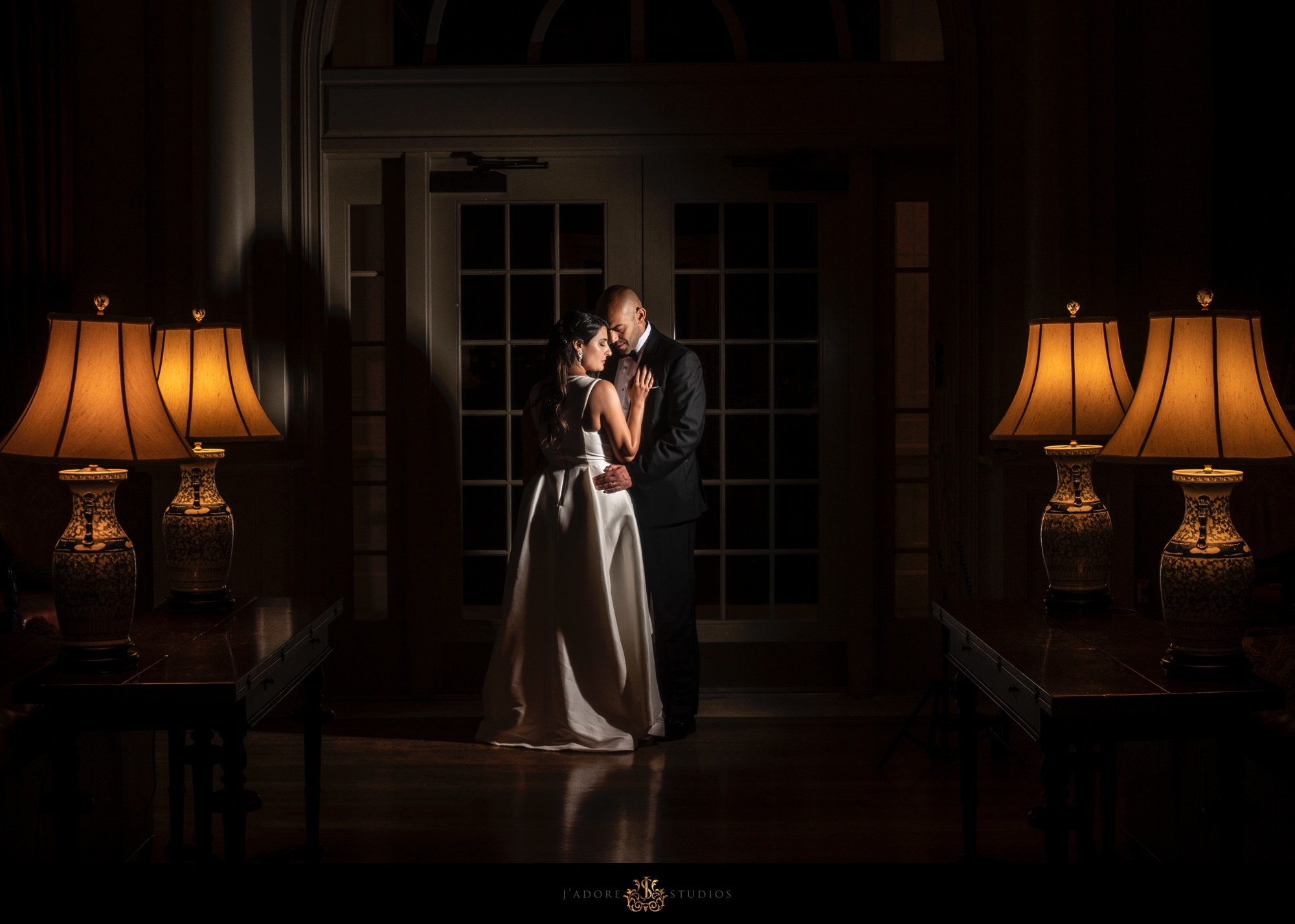Bride and groom hugging in the library in the River House in Saint Augustine Florida