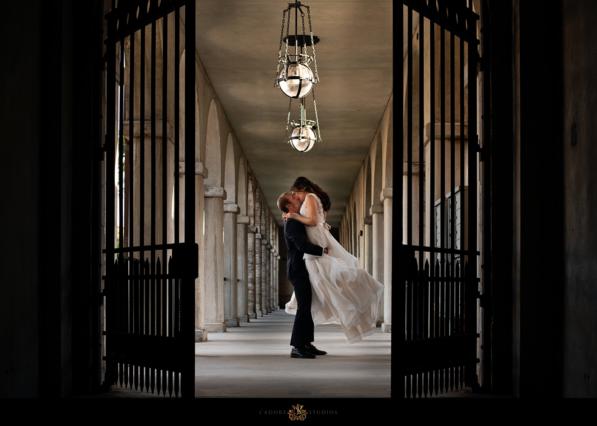 bride and groom kissing at lightner museum in saint Augustine Florida