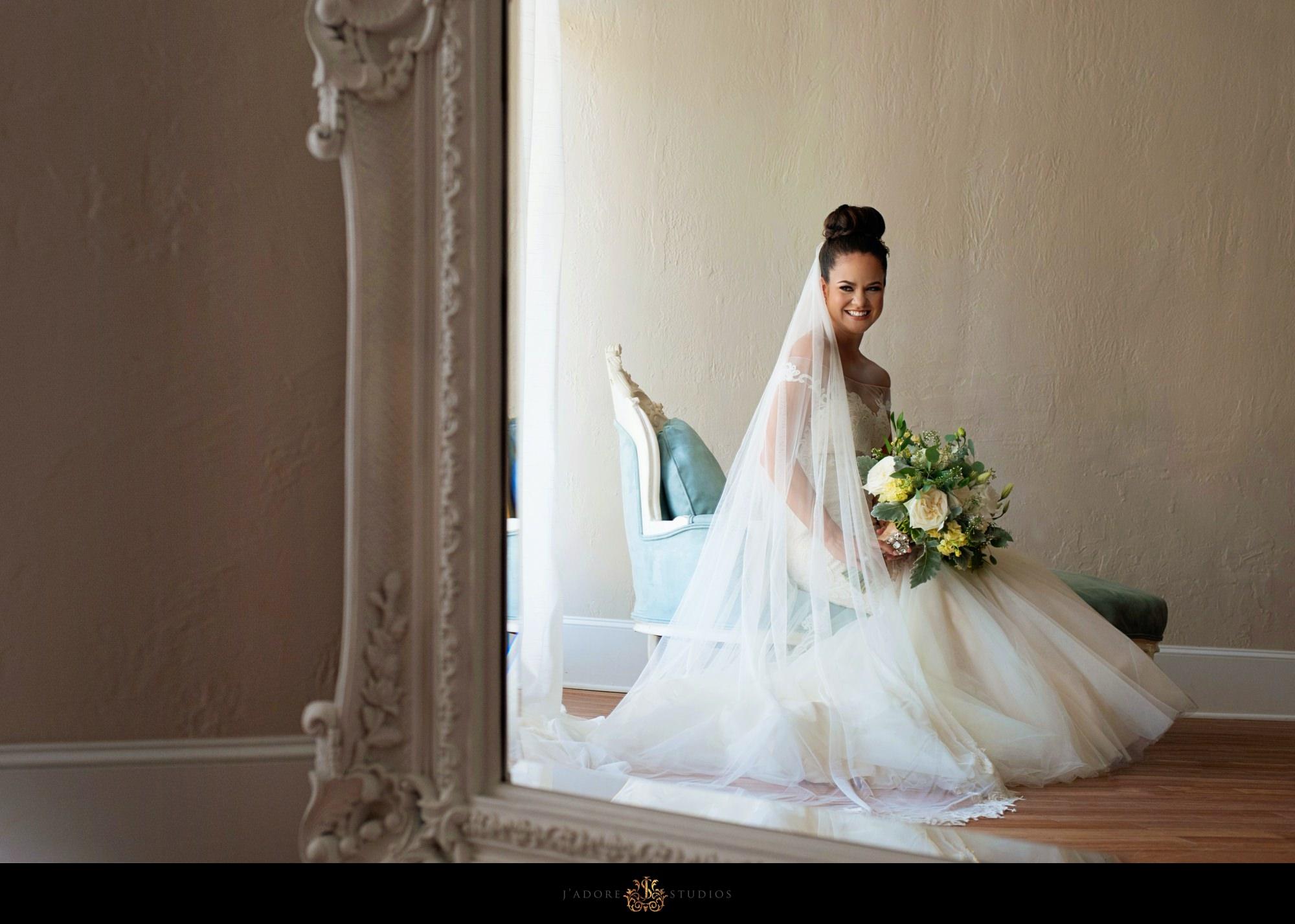 white room Saint Augustine - bride portrait in mirror in bride getting room