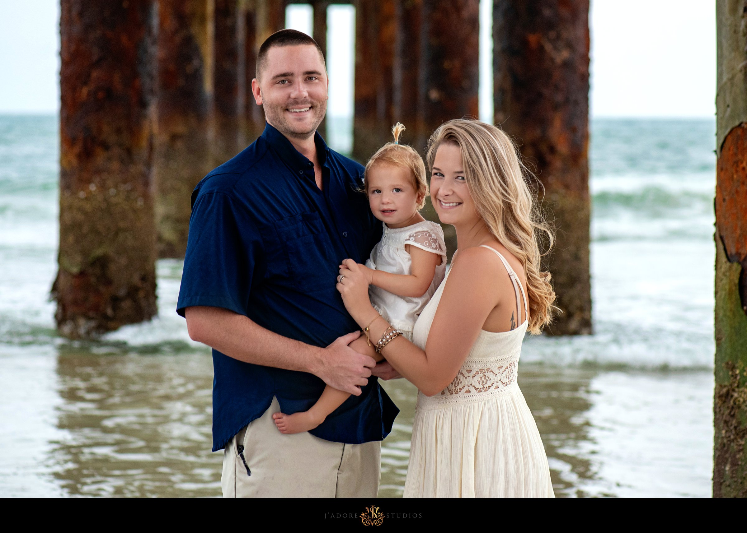 Family hugging and smiling at the camera in Saint Augustine Florida