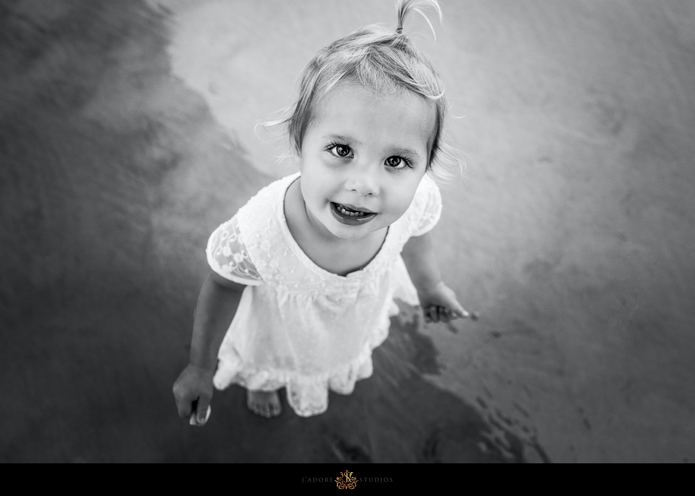 Black and white photo of little girl looking at the camera