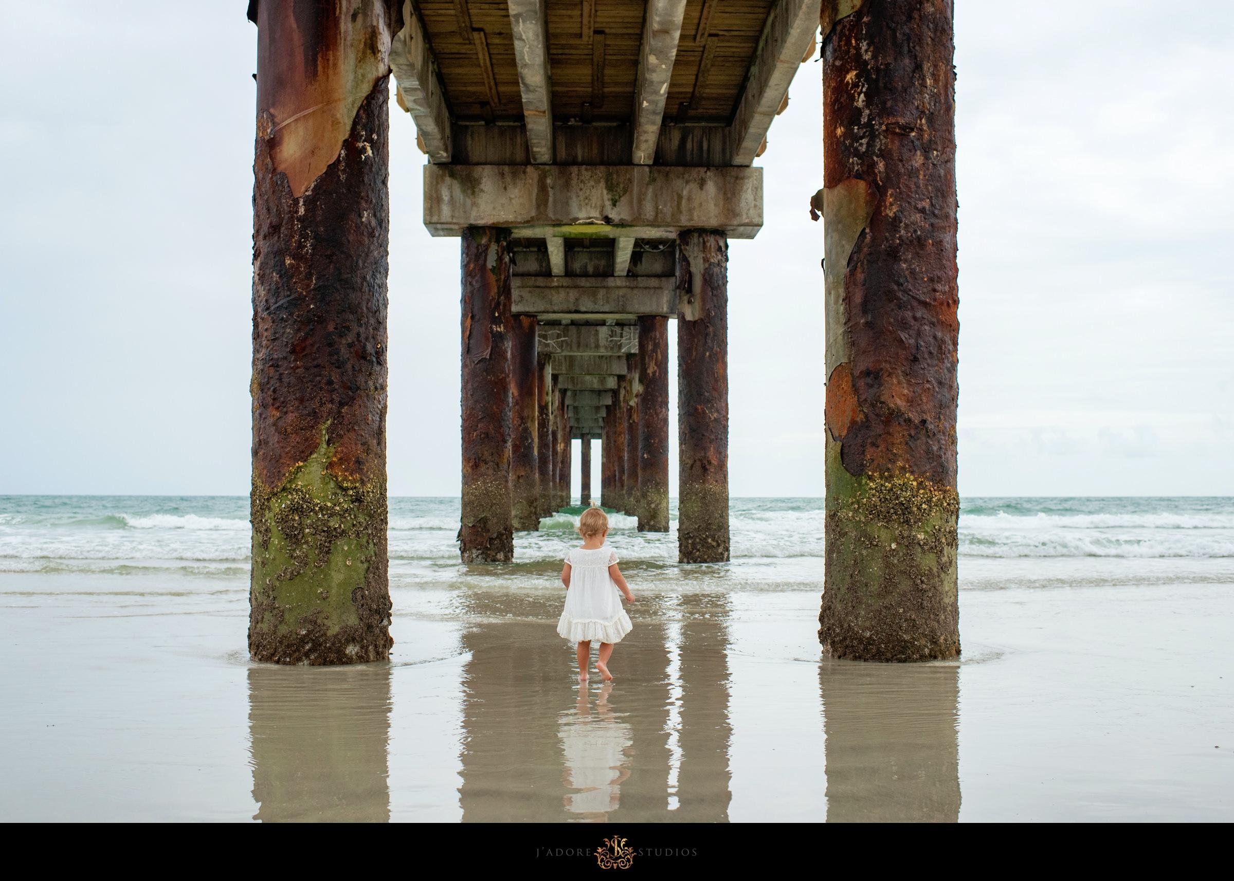 Little girl under the Saint Augustine Pier in Florida