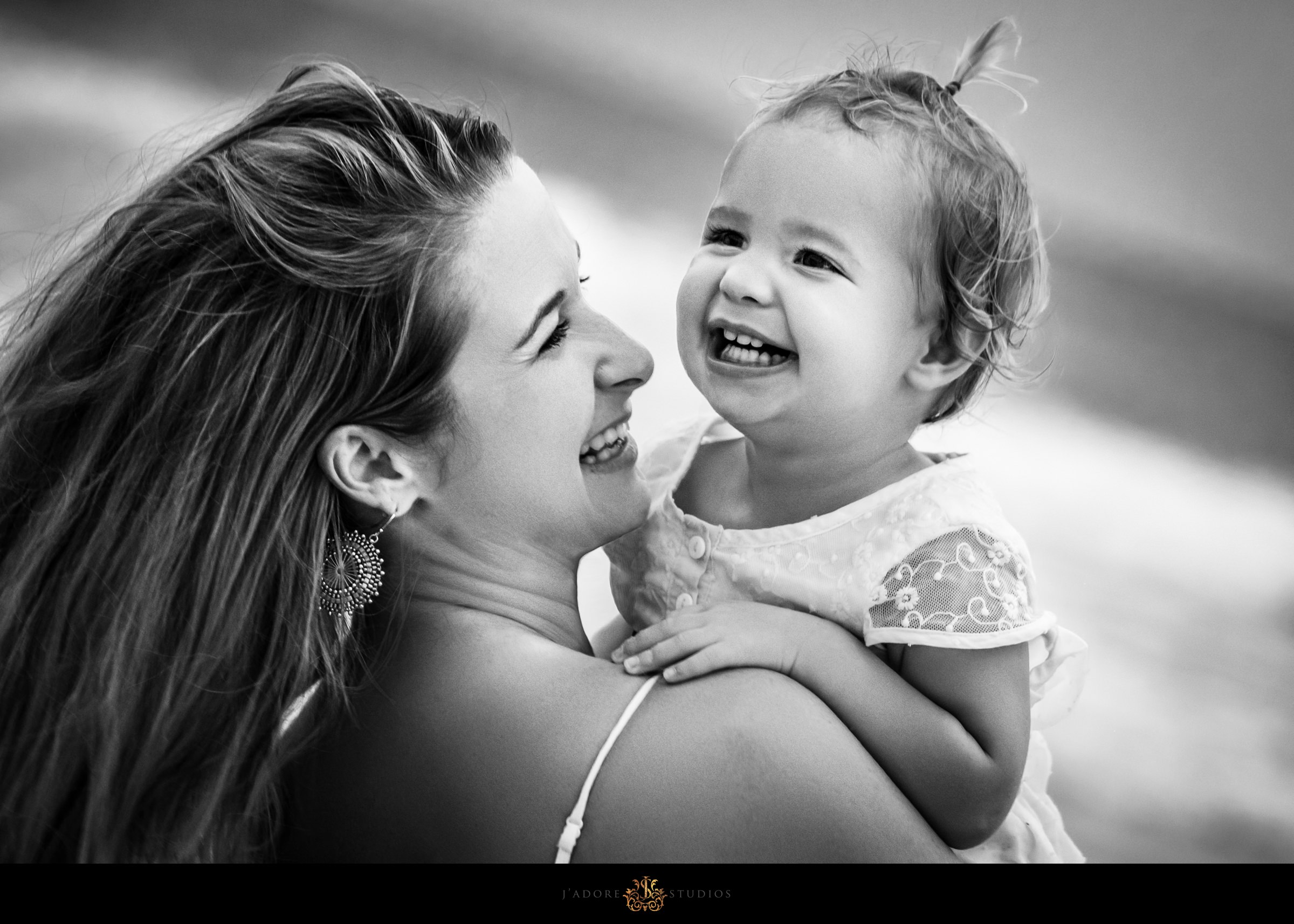 Mother and daughter laughing on the beach in Saint Augustine Florida